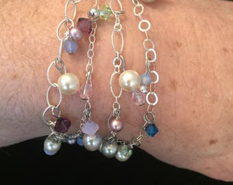 """7-1/2"""" silver 4-chain dangle bracelet with slide clasp."""