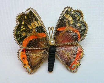 Vintage wire wrapped mesh butterfly pin with faux pearl accent