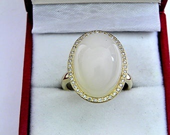AAAA White Moonstone 18 x 13mm  15.02 Carats   14K Yellow gold Diamond halo cabochon ring. 1516