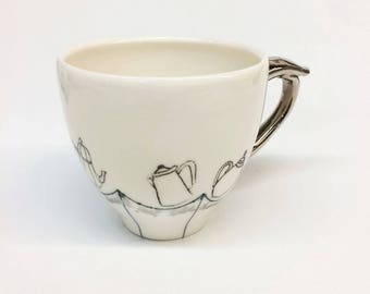 This doesn't feel like home- teapots- Teacup