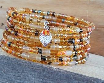 Memory Wire Cuff Bracelet -Orange Peach Golds Seed Beads - Silver Leaf Charm - Orange Swarovski Crystal - All Season Bracelet - Seed Beads