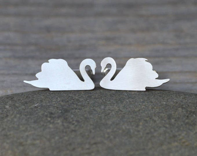 Swan and Elephant cufflinks for Maggie