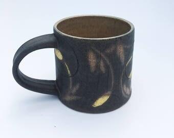 Handmade pottery mug in botanical moon
