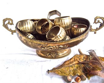 Vintage Hammered Brass Compote Full Of Miscellaneous Brass Napkin Rings Vintage Brass Home and Living Holiday Table Accessaries Vintage Set