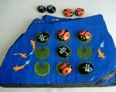 Tic tac toe game board hand painted rocks summer camping patio barbecue family fun Koi pond ladybugs dragonflies original art neon gold fish