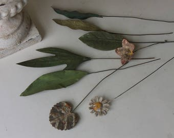 eight vintage rusty tin leaves and flowers