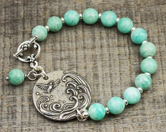Bird and wave bracelet, light blue amazonite beads, silver 7 1/2 inches long, Laurel Moon Jewelry