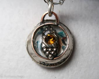Citrine in a silver finding set in hand hammered US quarter pendant featuring Oklahoma red dirt and turquoise shards
