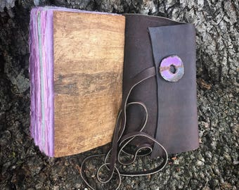 Lightweight hand-bound journal of handmade purple paper & Egyptian papyrus handbound to cowhide, found object cover accent