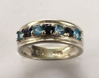 Vintage Sterling band with sapphire and aquamarine gemstones Ring size 7 marked C.A 925