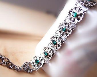 Fairy Tale--Aged silver brass, Swarovski emerald crystal, floral adjustable bracelet