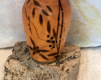 Wood carved small bamboo painted on a Romania vase.