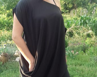 Unconventional and asymmetrical women dress