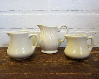 Collection of Three Creamy White Pottery Ironstone Type Farmhouse Pitchers