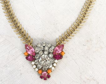 Vintage rhinestone assemblage pendant necklace; clear, pink, orange
