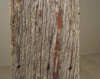 Reclaimed antique old barn wood with red paint and nail holes