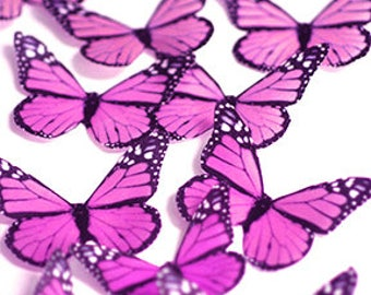 Pink edible butterflies, 12 wafer paper monarch butterflies for cake decorating and cupcake toppers. Butterflies for wedding cake toppers