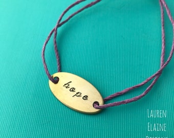 Custom Hand Stamped Brass Oval Charm Hemp Bracelet- (Pick your own Color and Phrase)