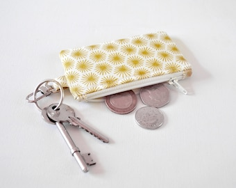 Women's metallic gold starburst 50's retro inspired change pouch key chain fob coin padded gadget purse in gold and cream print.