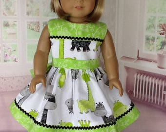 18 inch doll dress and hair clip. Fits American Girl dolls. Novelty giraffe print with lime green contrast.
