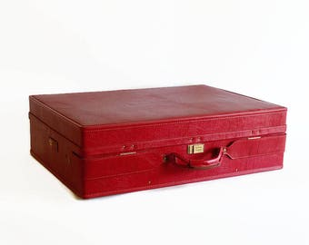 vintage large red leather suitcase with key Hartmann luggage