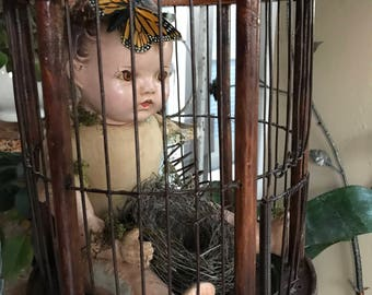 Vintage wood bird cage with fairy baby and nest
