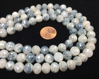 Shaded Blue Corundum Rounds Faceted