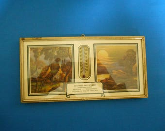Vintage pictorial advertising thermometer in frame  1940's