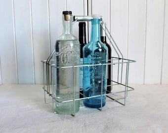 A super, vintage french, metal bottle carrier