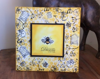 Bee-themed, stamped artwork  on canvas board for home decor