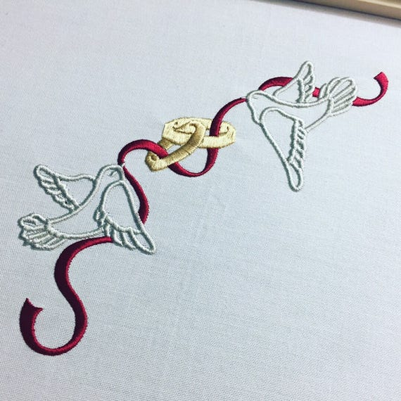 Doves with wedding rings and ribbon machine embroidery