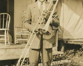 Handsome man w trumpet antique music photo