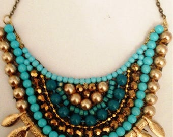 Gypsy turquoise Necklace - turquoise beads and rainstone gold plated leaves and gold plated chain - hand made.