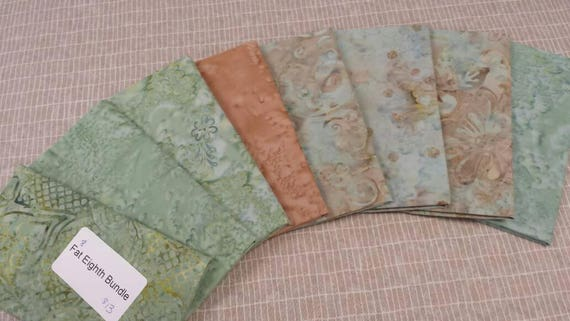 Batik Textiles Bundle of 8 Fat Eighths In Island Style Designs With Marbled Teal Green and Tan Peach Swirls , Flowers and Leaves