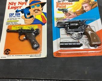 vintage set of mini die cast cap guns