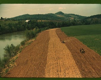 Planting corn along a river in northeastern Tennessee, 1940