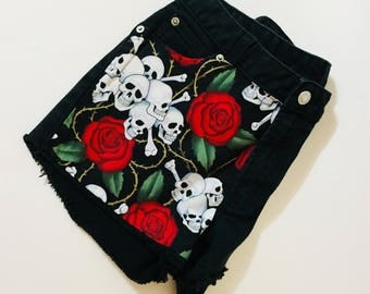 Black Death Shorts. Black Jean shorts with studs and unique fabric. Only one. Suggest size 4 Read measurements.