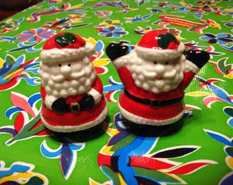 Vintage hand painted ceramic Santa Claus salt and pepper shakers