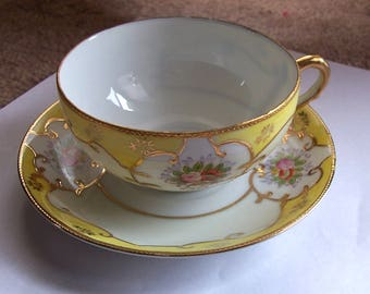 Beautiful Porcelain Occupied Japan Cup and Saucer in Yellow Decorated With Moriage and Signed