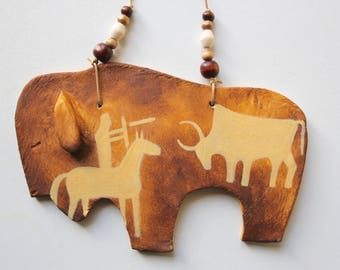 Buffalo southwestern spirit bison native american Indian symbols rock art petroglyphs medicine man desert southwest wall hanging beads clay