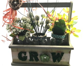 Floral arrangement 3 Canning jars in wooden country farmhouse tool style box with handle G-R-O-W spelled in moss letters & burlap flower