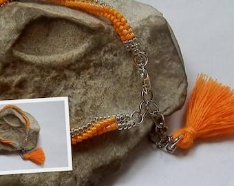 Tangerine and silver woven bracelet