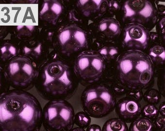 A 37-100 g of 4-12 mm glass pearl beads different sizes