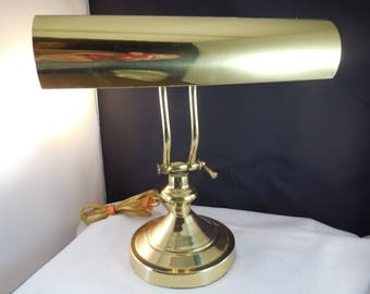 Brass bankers lamp or library lamp in good working condition.