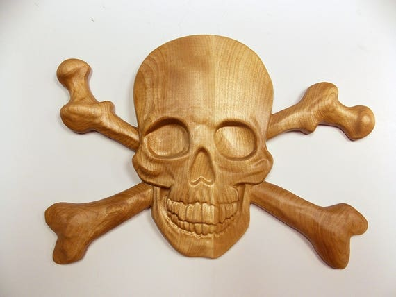 Skull and crossbones wood carving wall art