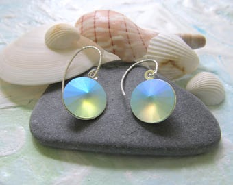 These earrings are etherial, they are like washed glass, they are Swarovski Crystal on sterling silver ear findings - they are beautiful