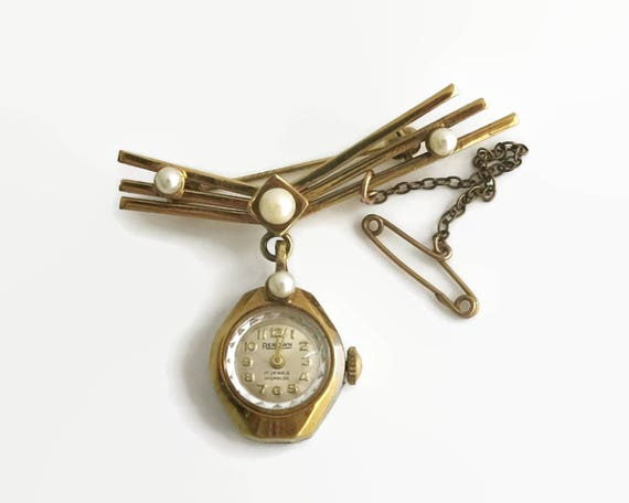 Gold plated watch brooch with 4 cultured pearls, Art Deco style, Renown, 17 Jewels, rollover closure, safety chain, mid 20th century