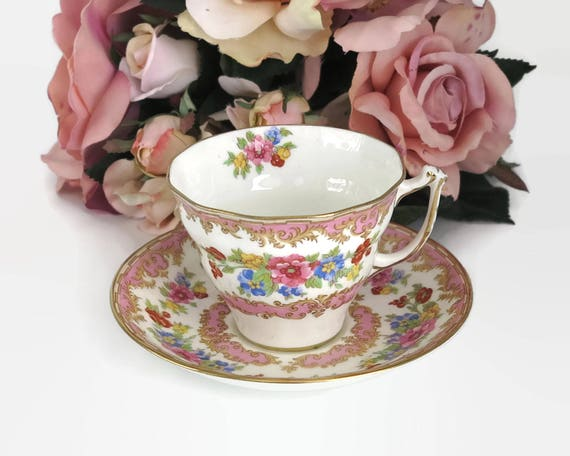 Vintage Old Royal China cup and saucer, made in England, pink and multi colored floral pattern, white background, pattern 2878, mid century