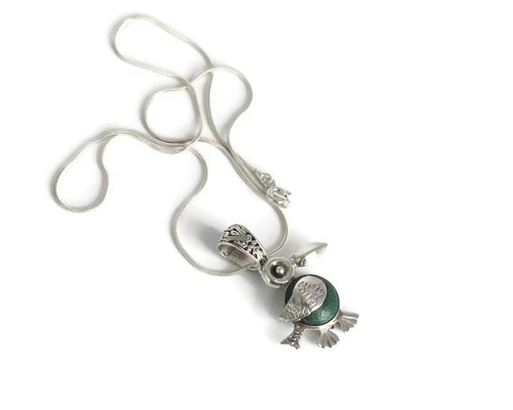Small sterling silver bird pendant with green stone on fine sterling silver snake chain, bird has engraved details, Mexican, vintage