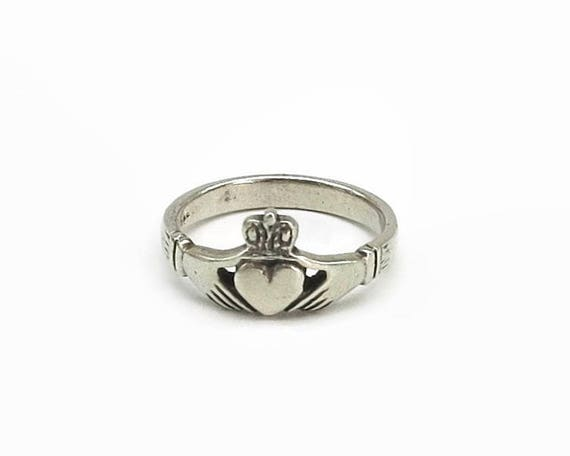Sterling silver Claddagh ring with classic symbols of the heart, hands, and a crown, stamped 925, size R / 8.5